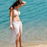 Summer toned woman walking beach in bikini — Stock Photo