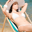 Summer slim woman sunbathing in bikini deckchair — Stock Photo