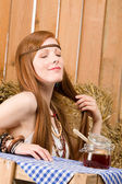 Redhead hippie young woman have breakfast in barn — Stock Photo