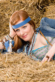 Young hippie woman lying on hay relax — Stock Photo