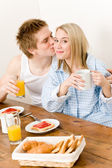 Breakfast happy couple enjoy romantic kiss — Stock Photo
