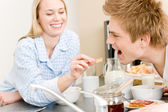 Breakfast happy couple woman feed man cereal — Stok fotoğraf