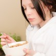 Young student girl eat cereal for breakfast — Stock Photo #5879332