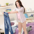 Student girl fitting trousers in the morning - Stok fotoğraf