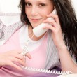 Young student girl speaking on phone lying — Stock Photo #5879384