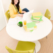 Foto Stock: Young student girl home study with laptop