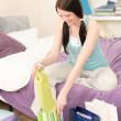 Young happy student unpack shopping bags — Stock Photo #5879455