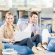 Group of high-school students with books sitting — Stock Photo #5879501