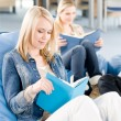 Young high-school student girls read books — Stock Photo #5879525