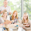 Group of high-school students with mature professor — Stock Photo