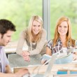 Group of young high school students learning - Stock Photo