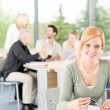 Young business students - businesswoman in front - Stock Photo