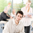 Stock Photo: Young business students - businessman in front