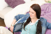 Young happy student relax leaning over bed — Stock Photo
