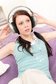 Young happy student with headphones listen music — Stock Photo