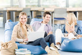 Group of high-school students with books sitting — Stock Photo