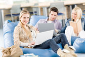 Group of high-school students with laptop sitting — Stock Photo