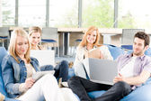 Group of young students at high school — Stock Photo