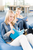 Young high-school student girls read books — Stock Photo