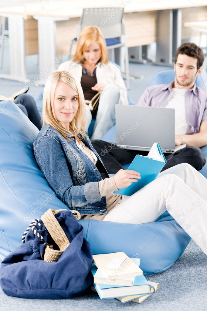 High-school or university study group with laptop sitting together — Stock Photo #5879526