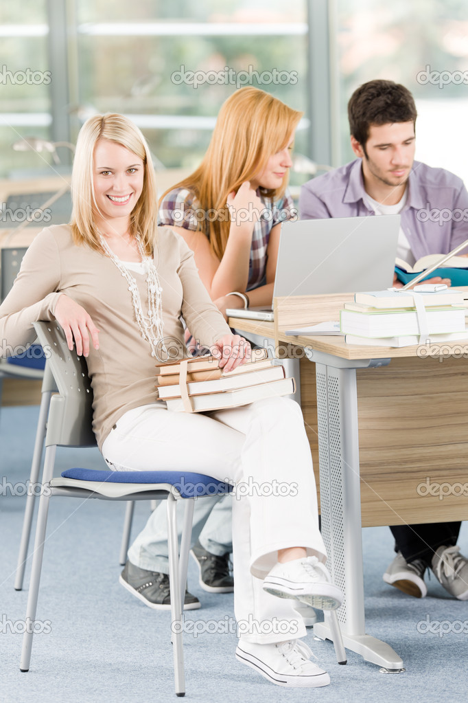 Group of young high school students learning relaxing with books — Stock Photo #5879549