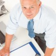 Senior man standing above office table — Stock Photo #5889139