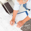 Senior man work on blueprints construction plans — Stock Photo