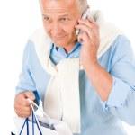 Senior happy man holding shopping bags — Stock Photo #5889183