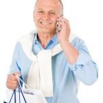 Senior happy man holding shopping bags — Stock Photo #5889184