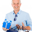 Mature smilling man hold shopping bags - Zdjęcie stockowe