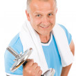 Happy mature man working out with dumbbells — Stock Photo