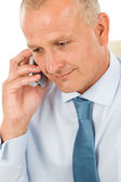 Smiling businessman on phone close-up portrait — Stock Photo