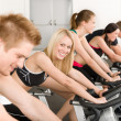 Fitness group of on gym bike - Stock Photo