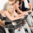 Stock Photo: Fitness group of on gym bike