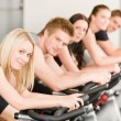 Fitness group of on gym bike — Stock Photo #5939317