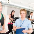 Stock Photo: Young fitness instructor gym exercise