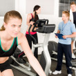 Foto Stock: Young fitness woman doing spinning with instructor