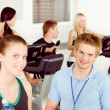 Young fitness instructor exercise at gym — Stock Photo