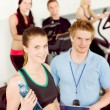 Young fitness woman doing spinning with instructor — Stock Photo #5939337