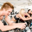 Fitness group of on gym bike — Stock Photo