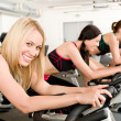 Fitness group of on gym bike — 图库照片