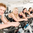 Fitness group of on gym bike — Stock Photo #5939340