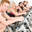 Fitness group of on gym bike — Stockfoto