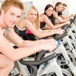 Fitness group of on gym bike — Stock Photo #5939342