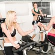 Fitness young girl on gym bike — Stock Photo