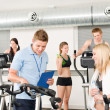 Young fitness instructor gym spinning — Stock fotografie