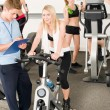 Foto Stock: Fitness young girls at gym with instructor