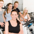 Fitness young group at gym bicycle — Stock Photo #5939365