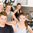 Fitness young group at gym bicycle — Stock Photo #5939366