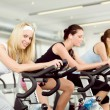 Fitness young womon gym bike spinning — Stock fotografie #5939378